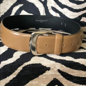 Tan leather belt with silver buckle.